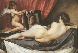 Aphrodite looking at herself in the mirror